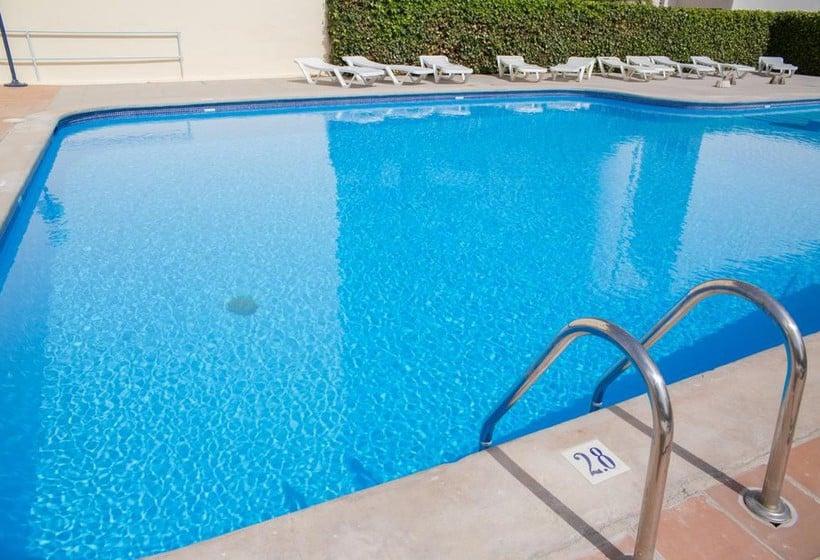 حمام سباحة NWT Hostal Sunset Ibiza سان أنطونى دى بورتمانى